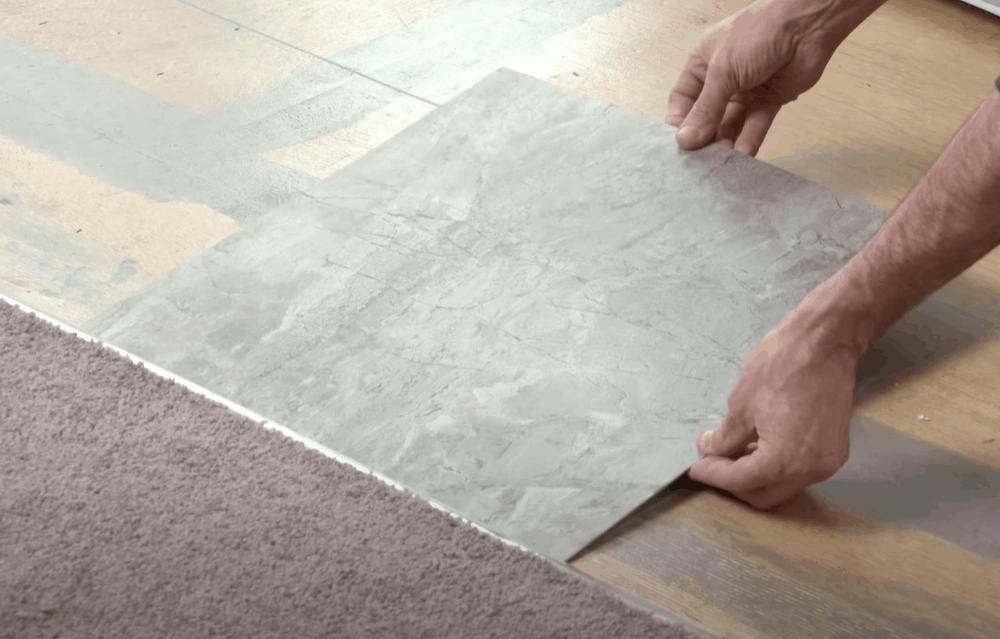 Lay the vinyl tiles