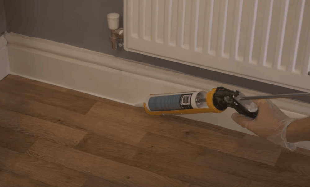 Clean Stray Adhesive and Replace the Baseboards