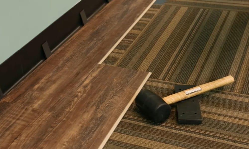 Can You Lay Laminate Or Vinyl Flooring, Can Laminate Flooring Be Laid Over Carpet Underlay