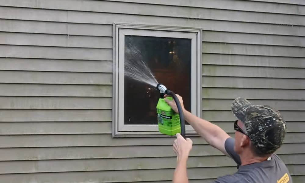 Clean vinyl siding using a pressure washer
