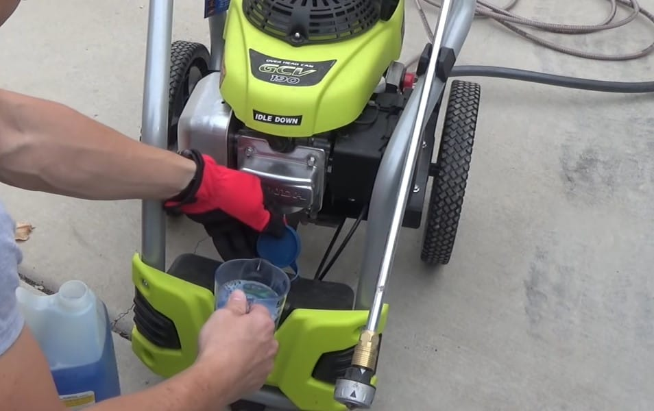 Fill the pressure washer reservoir with a cleaning solution