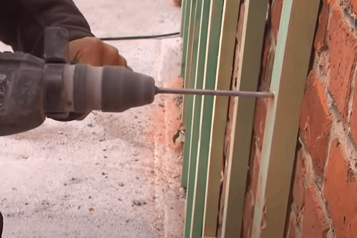 Nail the Furring Strips to the Brick