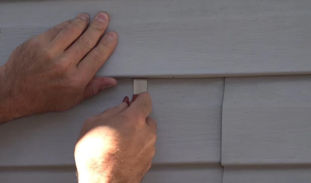 Remove the damaged vinyl siding