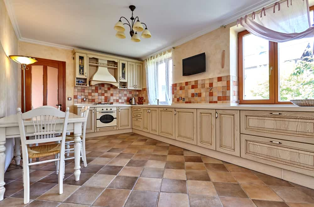 What are the advantages of vinyl flooring for kitchens