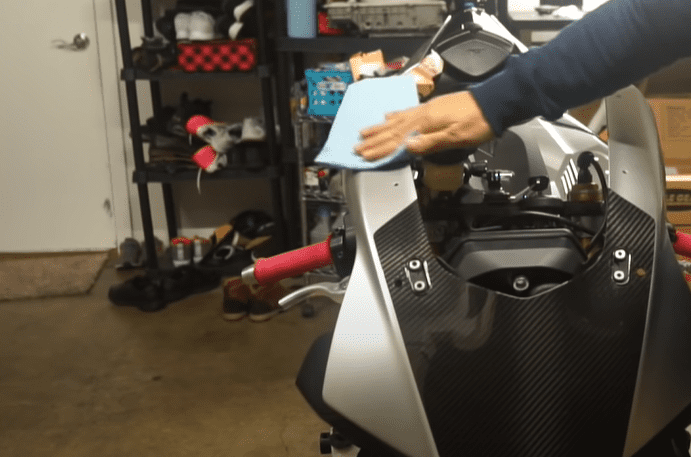 Clean the motorcycle surfaces and your work area