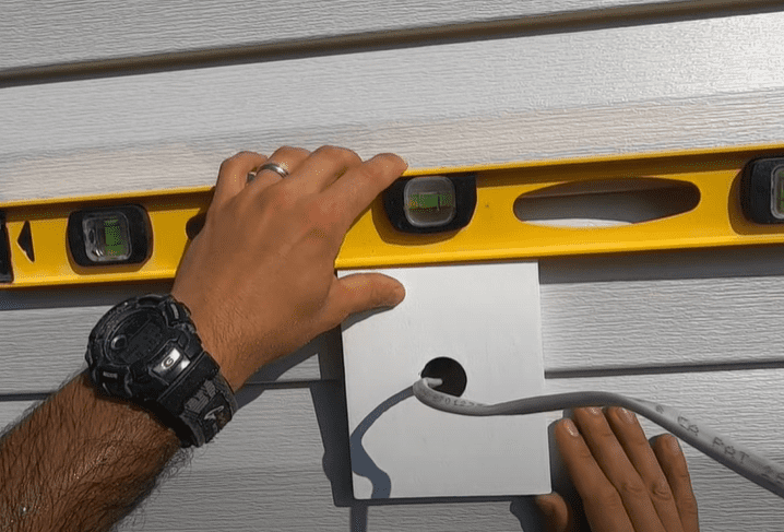 Fasten the mounting block to the house wrap